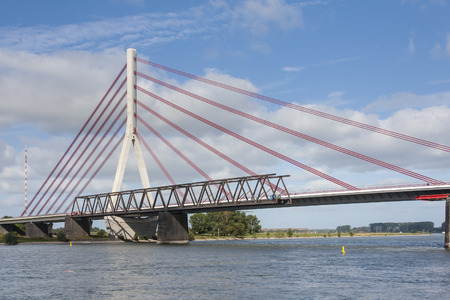 rhine westphalia: Deconstruction of an old bridge over Rhine river next to a new suspension bridge in Wesel, Germany Stock Photo