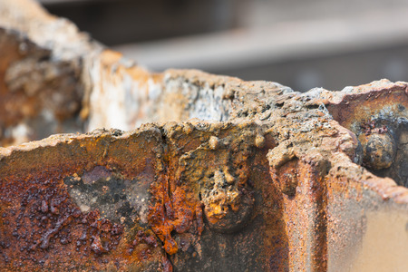deconstruction: Detail shot of cut rusty steel beams from an old bridge.