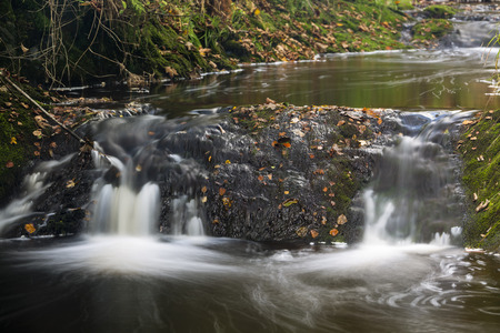the ardennes: Little waterfalls in a mountain river in the High Fens, Ardennes, Belgium, long exposure shot Stock Photo