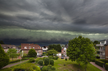 thunderstorm: Approaching Thunderstorm Over Residential District Stock Photo