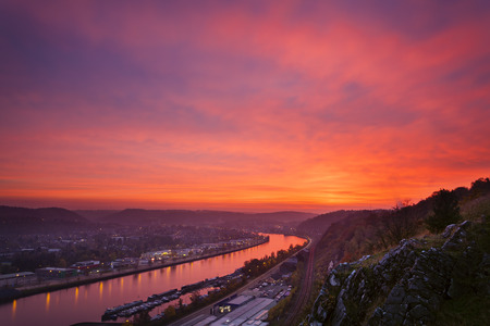 maas: View over the Meuse to Huy in Belgium during a fiery red sunset