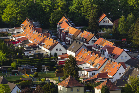 high angle view: High angle view of a little west German village with red roofs and large gardens near Aachen.