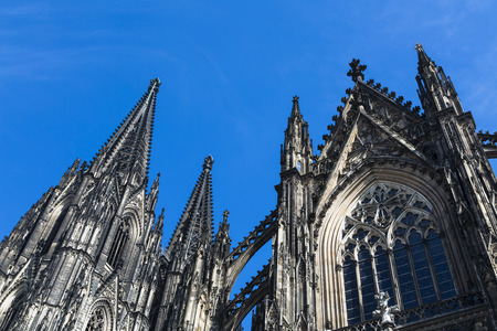 low angle: Cologne Cathedral low angle view from the side with blue sky