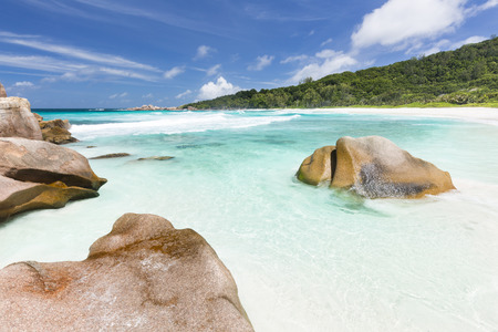 cocos: Granite boulders, white beach and turquoise water at Anse Cocos in La Digue, Seychelles