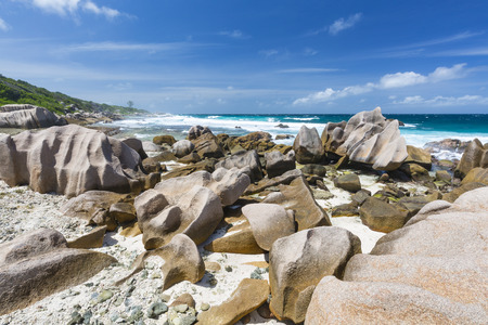 south coast: South coast of La Digue, Seychelles with granite rocks and tall waves Stock Photo