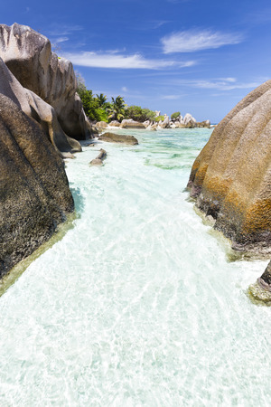 pristine corals: Beautiful white beach Anse Pierrot near Source DArgent in La Digue, Seychelles with granite rocks as frame