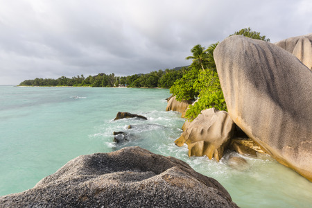 d'argent: Beautiful bay Anse Source DArgent in La Digue, Seychelles with scenic granite rocks in evening light