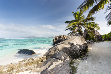 d'argent: The footpath to Anse Source DArgent in La Digue, Seychelles with view to Praslin Stock Photo