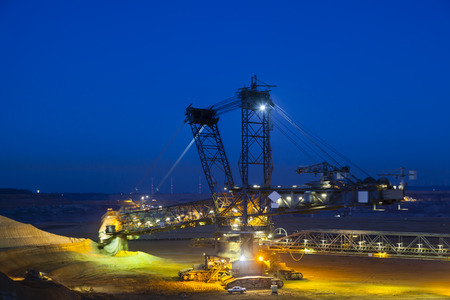 A giant Bucket Wheel Excavator at work in a lignite pit mine at night with some motion blur Standard-Bild