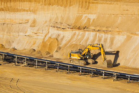 lignite: A small excavator at parked in a lignite pit mine Stock Photo
