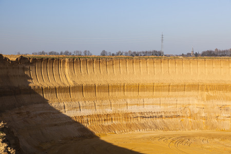 lignite: A steep lignite pit mine wall in warm evening light