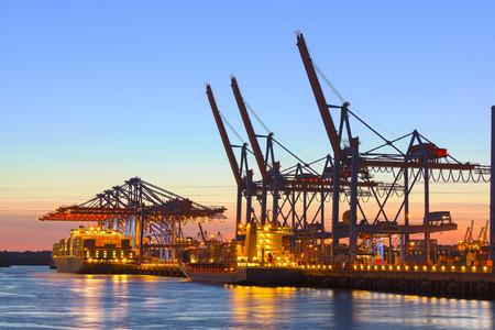 Container ship at a terminal at dusk Standard-Bild