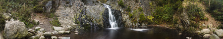 Panoramic view of a waterfall in a canyon in the High Fens, Ardennes, Belgium. Long exposure shot.