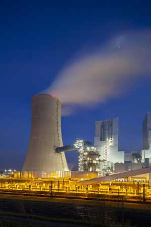 powerplant: A modern brown coal power station with night blue evening sky. Stock Photo