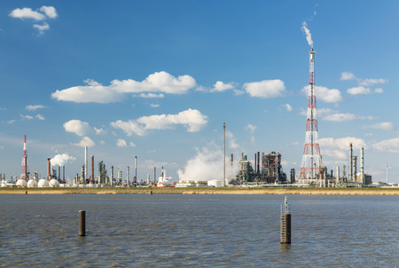 flare stack: A refinery with tall flare stack in the port of Antwerp, Belgium with lots of distillation towers. Stock Photo