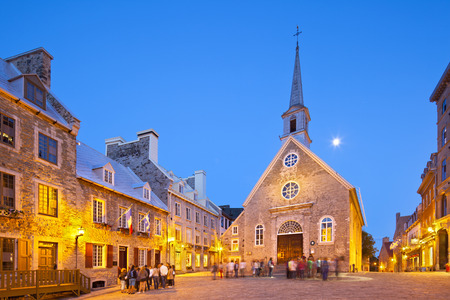 Quebec City - June 20: Notre-Dame-des-Victoires at Place Royale in Quebec City, Canada with its old buildings on June 20, 2013 Publikacyjne