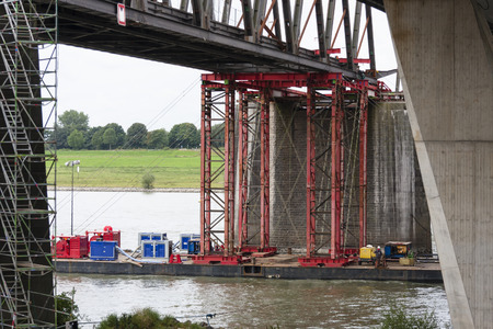 deconstruction: Industrial carrying platform supporting a bridge deconstruction on rhine river, Germany.