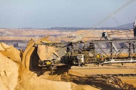 lignite: A giant Bucket Wheel Excavator at work in a lignite pit mine Stock Photo