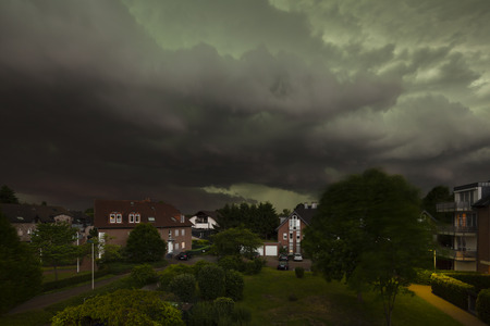 severe weather: Approaching Thunderstorm Over Residential District Stock Photo