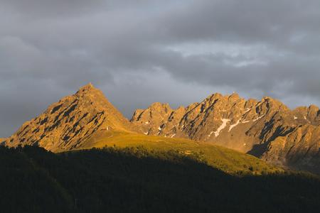 Colorful Alpenglow in the mountains near Nauders, Austria Standard-Bild