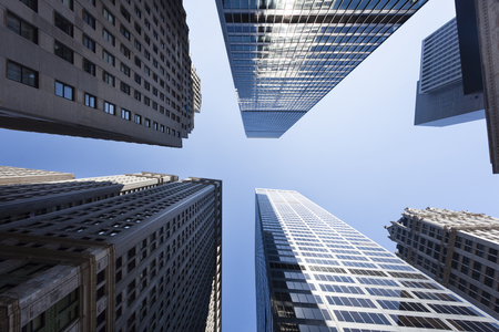 buildings city: Low angle view of skyscrapers in the Financial District of New York, USA Stock Photo