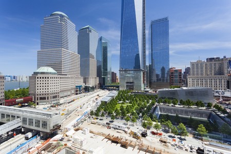 9 11: New York City - June 23: The almost finished One World Trade Center and memorial site in New York with blue sky  on June 23, 2013
