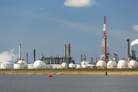 distillation: A large refinery with gas storage tanks in the port of Antwerp, Belgium with lots of distillation towers.