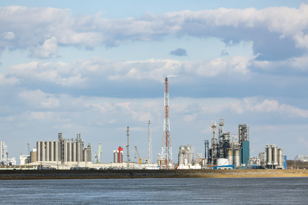 flare stack: A large oil refinery with flare stack in the port of Antwerp, Belgium with lots of distillation towers. Stock Photo