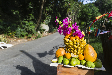 la digue: Fruit pile at a roadside bar serving freshly squeezed fruit juices in La Digue, Seychelles