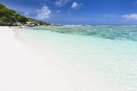 pristine corals: Perfect white beach Anse Pierrot near Source DArgent in La Digue, Seychelles