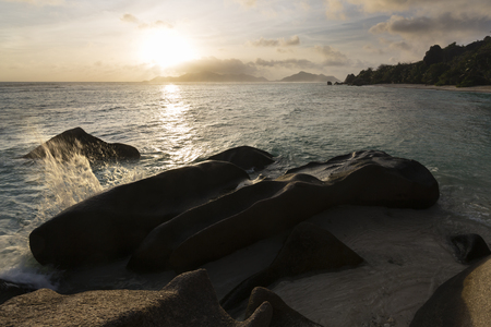 d'argent: Sunset at Anse Source DArgent in La Digue, Seychelles with a granite rock in the foreground