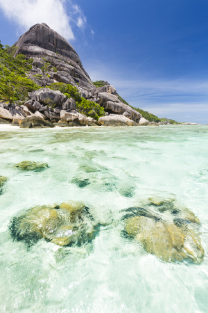 d'argent: Turquoise water and coral reef at Anse Source DArgent in La Digue, Seychelles Stock Photo