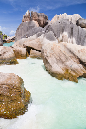 cocos: Granite rock formation and turquoise water at Anse Cocos in La Digue, Seychelles