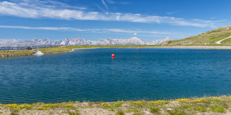 A reservoir lake with red balloons in the Pitztal, Austria