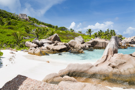 la digue: Granite rock formations and turquoise water at Anse Cocos in La Digue, Seychelles Stock Photo