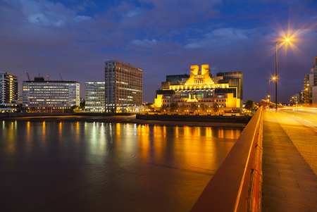 james: The modern Secret Intelligence Service building in Vauxhall, London at night with the Vauxhall Bridge in the foreground Stock Photo