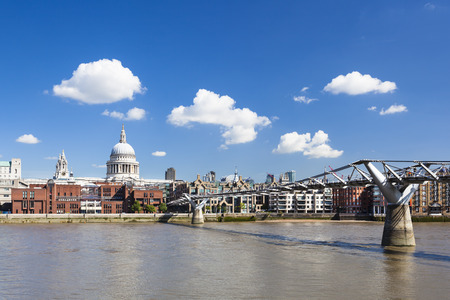 st pauls: Millennium Bridge in London with St. Pauls Cathedral in the background and a beautiful sky