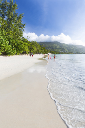 beau: MAHE - AUGUST 08: Tourists and locals at Beau Vallon Beach in the west of Mahe, Seychelles on August 08, 2014