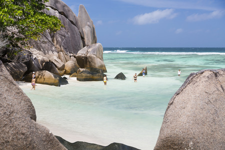 d'argent: LA DIGUE - AUGUST 15: Tourists on the beach at Anse Source DArgent in La Digue, Seychelles on August 15, 2014