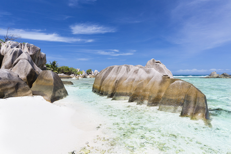 pristine coral reef: Beautiful white beach Anse Pierrot near Source DArgent in La Digue, Seychelles with granite rocks in the foreground