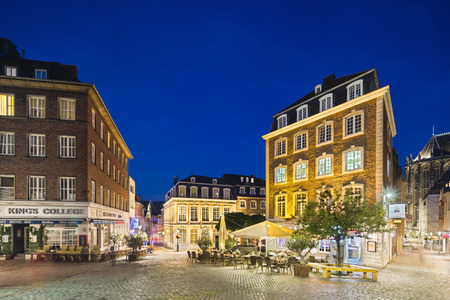 night shift: AACHEN - AUGUST 02: Restaurants and the Couven-Museum next to the old town hall of Aachen, Germany with night blue sky. Taken with a shift lens on August 02, 2015