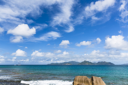 la digue: View at the wild north coast of La Digue, Seychelles with the island of Praslin in the background