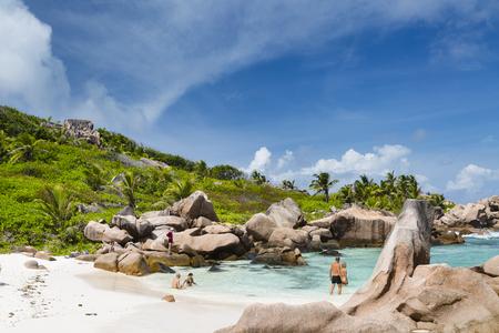 la digue: LA DIGUE - AUGUST 10: Tourists enjoying the perfect beach Anse Cocos in La Digue, Seychelles on August 10, 2014