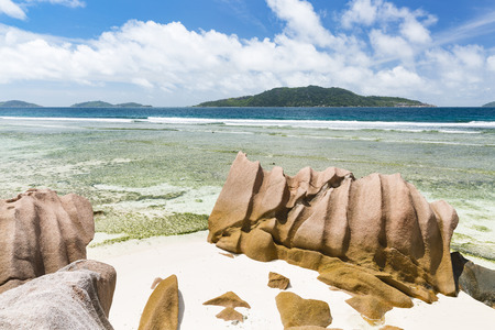 Anse Banane in La Digue, Seychelles with clear water and granite rocks Standard-Bild