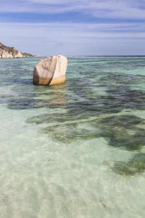 d'argent: Granite rock in the lagoon of Anse Source DArgent in La Digue, Seychelles with blue sky
