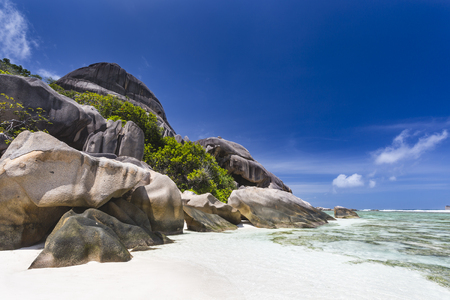 d'argent: Beautiful white beach Anse Source DArgent in La Digue, Seychelles with granite rocks in the background
