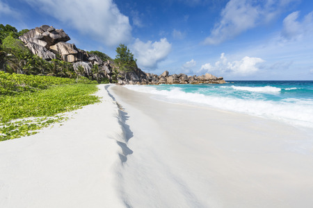 perfect waves: Perfect white beach Grand Anse in La Digue, Seychelles with ist famous granite rock formations