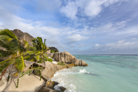 d'argent: The famous wedding ceremony spot at Anse Source DArgent in La Digue, Seychelles with scenic granite rocks in evening light Stock Photo
