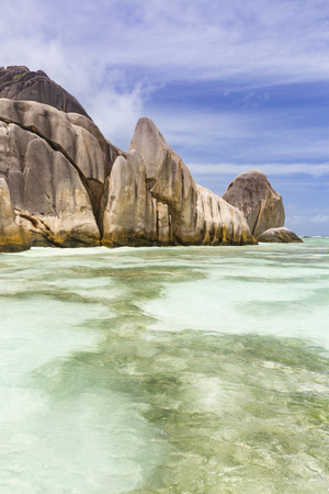 la digue: Turquoise water and coral reefs in front of the La Digue coastline, Seychelles with granite rocks