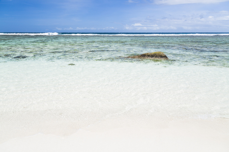 pristine corals: Perfect white beach Anse Pierrot with shallow lagoon near Anse Source DArgent in La Digue, Seychelles Stock Photo